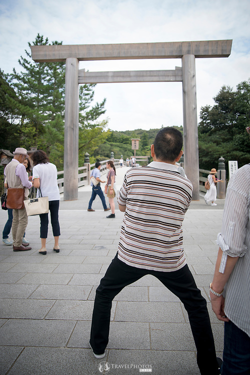 Tourists at the Ise Shrine grounds entrance.