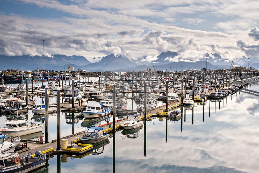 The City of Homer Port & Harbor marina on the Kachemak Bay overlooking the Kenai Mountains in Homer, Alaska.