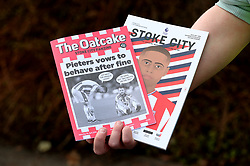 """A match programme and a Stoke City fanzine called the Oatcake before the Premier League match at the bet365 Stadium, Stoke. PRESS ASSOCIATION Photo. Picture date: Saturday April 7, 2018. See PA story SOCCER Stoke. Photo credit should read: Nigel French/PA Wire. RESTRICTIONS: EDITORIAL USE ONLY No use with unauthorised audio, video, data, fixture lists, club/league logos or """"live"""" services. Online in-match use limited to 75 images, no video emulation. No use in betting, games or single club/league/player publications."""
