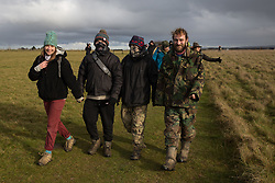 Salisbury, UK. 5th December, 2020. Over one hundred people, including local residents, climate and land justice activists and pagans, arrive to take part in a Mass Trespass at Stonehenge. The trespass was organised in protest against the approval by Transport Secretary Grant Shapps of a £1.7bn project for a two-mile tunnel beneath the World Heritage Site and a further eight miles of dual carriageway for the A303, as well as the government's £27bn Road Investment Strategy 2 (RIS2).