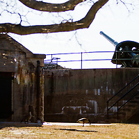 """Batttery Gunnison, built in 1904 as part of Fort Hancock's Endicott period defenses.  The battery's two guns were originally mounted on counterweight carriages.  These so-called """"disappearing"""" guns recoiled back to their loading position behind the protective concrete wall each time they fired their 6-inch caliber shells.  <br /> <br /> During World War II, the army raised Battery Gunnison's gun platforms and mounted two barbette guns here.  These guns were also 6-inch diameter, but could rapid-fire 108lb armored piercing projectiles more than 10 miles in any direction.    The Battery Gunnison's Barbettes are the only guns at Fort Handcock not scrapped after World War II."""