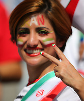 A female Iran with her nails painted in the colours of the national flag