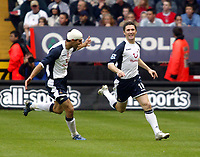 Photo: Chris Ratcliffe.<br />Charlton Athletic v Tottenham Hotspur. The Barclays Premiership. 01/10/2005.<br />Robbie Keane celebrates the winning goal as a strapped up Paul Stalteri tries to catch him