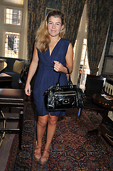AMBER AIKENS at a lunch in aid of the charity Kids Company held at Mark's Club, 46 Charles Street, London on 3rd October 2011.