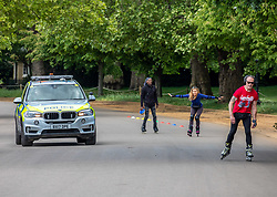 © Licensed to London News Pictures. 14/05/2020. London, UK. Police step up patrols in Hyde Park in London as members of the public go out in the sunshine to exercise after the Government relaxes the law on lockdown to let people spend more time outside to have picnics, sunbath, exercise and meet up with other people as weather experts predict a warmer week ahead. Photo credit: Alex Lentati/LNP