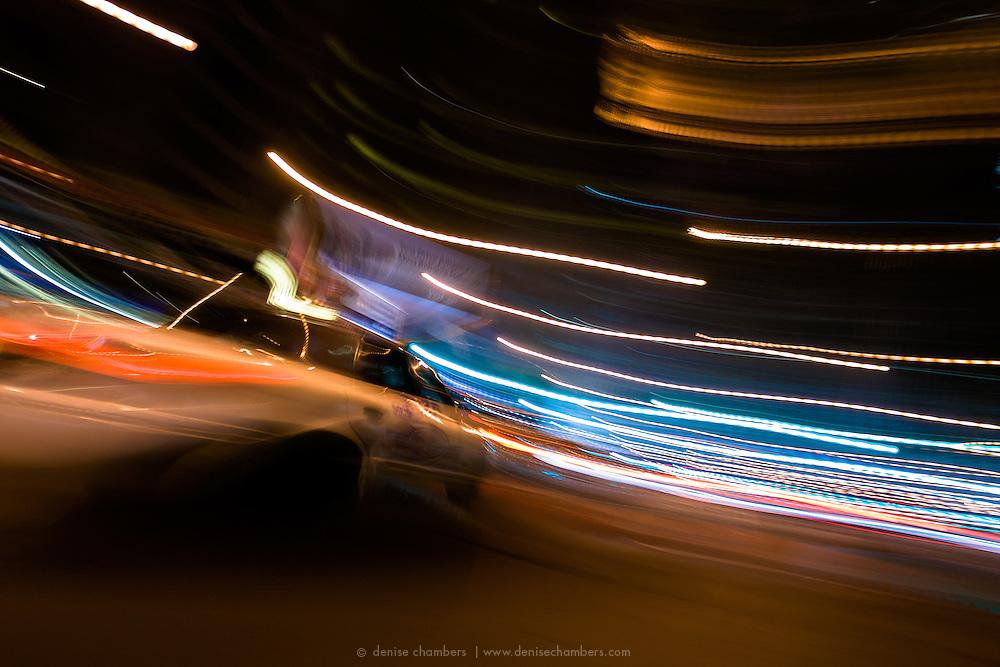 Taxi cabs streak down Michigan Avenue (Magnificent Mile) in Chicago, Illinois