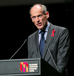 © Licensed to London News Pictures. 20/07/2014.  Dutch ambassador for HIV/Aids, Lambert Grijns, reads a letter out on behalf of the Netherlands in tribute during the official opening ceremony of the 20th International AIDS conference held in Melbourne Australia on July 20, 2014. This conference takes place a few days after the death of a number of high profile delegates and researchers due to attend whom flew on Malaysian Airlines flight MH17. Photo credit : Asanka Brendon Ratnayake/LNP