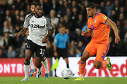 Derby County midfielder Florian Jozefzoon and Cardiff City defender Lee Peltier challenge for the ball during the EFL Sky Bet Championship match between Derby County and Cardiff City at the Pride Park, Derby, England on 13 September 2019.
