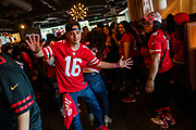 SAN FRANCISCO, CA - FEBRUARY 02: A San Francisco 49ers fan dances during a Super Bowl LIV watch party at SPIN San Francisco on February 2, 2020 in San Francisco, California. The San Francisco 49ers face the Kansas City Chiefs in Super Bowl LIV for their seventh appearance at the NFL championship, and a potential sixth Super Bowl victory to tie the New England Patriots and Pittsburgh Steelers for the most wins in NFL history. (Photo by Philip Pacheco/Getty Images)