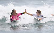 Eva Henderson and Saffi Vette. Finals of the Surfing New Zealand National Championships 2021. Piha Beach, Auckland, New Zealand. Saturday 16 January 2021.<br /> © image by Andrew Cornaga / www.Photosport.nz