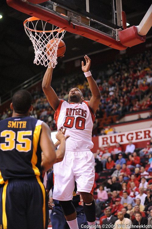 Feb 22, 2009; Piscataway, NJ, USA; Rutgers forward Gregory Echenique (00) puts up a basket during the first half of Rutgers' 74-56 loss to West Virginia at the Louis Brown Athletic Center.