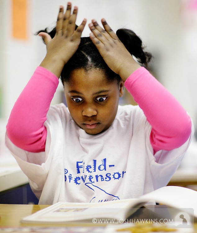 Tea Johnson opening and looking at her test book at the beginning of a week of state mandated testing at at Field Stevenson Elementary in Forest Park, IL..