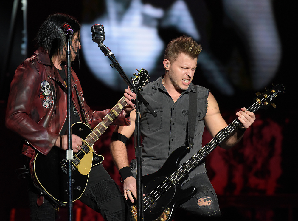 Three Days Grace singer Matt Walst, left, and bassist Brad Walst, right, perform Feb. 25, 2019, at Madison Square Garden in New York City.