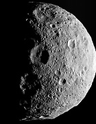 NASA's Dawn spacecraft obtained this image with its framing camera on July 17, 2011. It was taken from a distance of about 9,500 miles (15,000 kilometers) away from the protoplanet Vesta. Each pixel in the image corresponds to roughly 0.88 miles (1.4 kilometers).