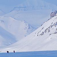 An expedition descends Nordenskjold Glacier on Spitsbergen Island, Svalbard, Norway.