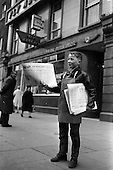 1963 - Newsboy outside Aer LIngus office on O'Connell Street