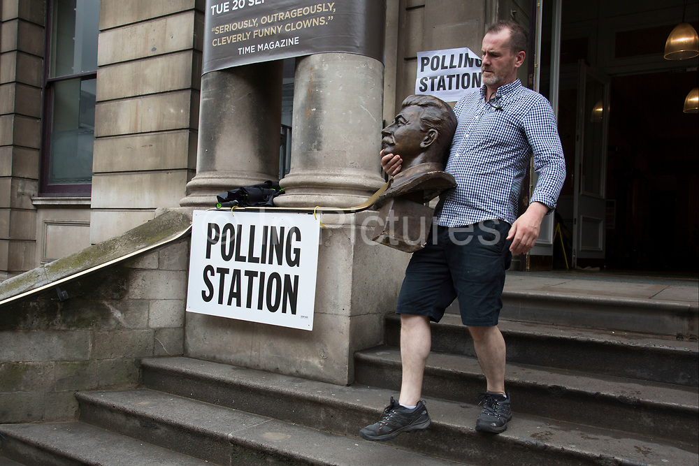 Workman removes the head of Joseph Stalin at the polling station at Shoreditch Town Hall during the UK's EU Referendum Polling Day on June 23rd 2016 in London, United Kingdom. Membership of the European Union has been a topic of debate in the UK since the country joined the EEC, or Common Market in 1973. It will be the second time the British electorate has been asked to vote on the issue of Britain's membership: the first referendum being held in 1975, when continued membership was approved by 67% of voters. The two sides are the  Leave Campaign, commonly referred to as a Brexit, and those of the Remain Campaign who are also known as the In Campaign. (photo by Mike Kemp/In Pictures via Getty Images)