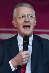 London, UK. 19 October, 2019. Hilary Benn, Labour MP for Leeds Central, addresses hundreds of thousands of pro-EU citizens at a Together for the Final Say People's Vote rally in Parliament Square as MPs meet in a 'super Saturday' Commons session, the first such sitting since the Falklands conflict, to vote, subject to the Sir Oliver Letwin amendment, on the Brexit deal negotiated by Prime Minister Boris Johnson with the European Union.