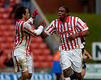 Photo. Glyn Thomas. 05/03/2005.<br /> Stoke City v Brighton. Coca Cola Championship.<br /> Stoke's Kenwyne Jones (R) celebrates scoring the second of his penalties with Darel Russell.