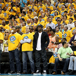 April 22, 2011; New Orleans, LA, USA; New Orleans Saints running back Reggie Bush (center) watches courtside during the second half in game three of the first round of the 2011 NBA playoffs between the New Orleans Hornets and the Los Angeles Lakers at the New Orleans Arena. The Lakers defeated the Hornets 100-86.   Mandatory Credit: Derick E. Hingle