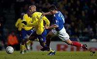 Photo: Richard Lane.Digitalsport<br /> Portsmouth v Chelsea. Barclaycard Premiership.<br /> 11/02/2004.<br /> Thierry Henry breaks past Arjan De Zeeuw.