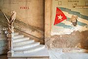 Staircase with Cuban flag and Camilo Cienfuegos mural leading to La Guarida Paladar, Havana, Cuba