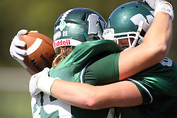 08 September 2012:  Tate Musselman is embraced by Parker Carroll after scoring a touchdown during an NCAA division 3 football game between the Alma Scots and the Illinois Wesleyan Titans which the Titans won 53 - 7 in Tucci Stadium on Wilder Field, Bloomington IL