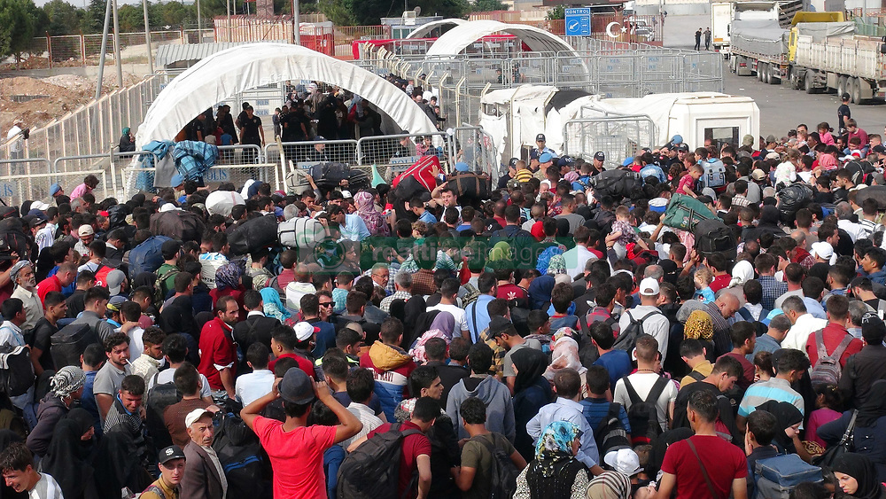 June 16, 2017 - Kilis, Turkey - Thousands of refugees walked back home into Syria from Turkey on June 16 ahead of the Eid festival that marks the end of the Muslim holy month of Ramadan. Turkey has taken in some 3 million Syrian migrants since the start of civil war in 2011, making it home to the world's largest refugee population. Now Ankara is giving Syrian refugees the right to return to Turkey within a month if they want to go home to celebrate the Eid al-Fitr holiday. Some said they wanted to start again in their homeland, and would return within the month if it did not work out, while others said they wanted to return to Syria for good, citing the difficulty of finding employment in Turkey. (Credit Image: © Dha/Depo Photos via ZUMA Wire)