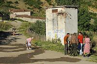 Street-life on the village road. Lesser Lake Prespa, Lake Prespa National Park, Albania June 2009