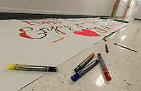 Laconia High School students work on Homecoming preparations for Friday afternoon's festivities.  (Karen Bobotas/for the Laconia Daily Sun)