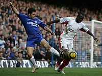 Photo: Lee Earle.<br /> Chelsea v Birmingham City. The Barclays Premiership.<br /> 31/12/2005.<br /> Chelsea's Joe Cole (L) battles with Olivier Tebily.