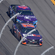 Denny Hamlin (11) and Darrell Wallace Jr. (43) race during the 60th Annual NASCAR Daytona 500 auto race at Daytona International Speedway on Sunday, February 18, 2018 in Daytona Beach, Florida.  (Alex Menendez via AP)