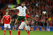 Daryl Murphy of Republic of Ireland (l) jumps to win the ball over Ashley Williams of Wales. Wales v Rep of Ireland , FIFA World Cup qualifier , European group D match at the Cardiff city Stadium in Cardiff , South Wales on Monday 9th October 2017. pic by Andrew Orchard, Andrew Orchard sports photography