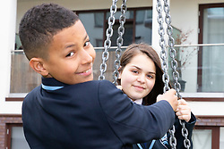 Friends Sienna, 13 and Gene, 11 on the swings. Sienna's family are from the social housing section of the complex. Social housing residents are up in arms after having their children forbidden from using a play area overlooked by their homes as it is said to be only available to the children of those who have bought properties at the new Baylis Old School housing development in Lambeth, South London . London, March 26 2019.