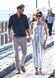 Prince Harry Duke of Sussex and Meghan Duchess of Sussex arriving at Kingfisher Jetty, Fraser Island, Australia . Photo credit should read: Doug Peters/EMPICS