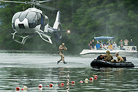The Navy Seal Team jumping from their helicopter during the mission demonstration on Wellington State Beach at Newfound Lake Friday afternoon.  (Karen Bobotas/for the Laconia Daily Sun)