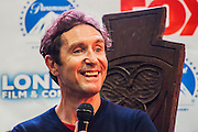 A panel discussion on Doctor Who, with John Hurt, writer Stephen Moffat and Paul McGann (pictured). London Film and Comic Con 2014, (LFCC), at Earls Court, London, UK.