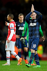 Man Utd Forward Wayne Rooney (ENG) applauds the away supporters after the game ends with a 0-0 draw - Photo mandatory by-line: Rogan Thomson/JMP - 07966 386802 - 12/02/14 - SPORT - FOOTBALL - Emirates Stadium, London - Arsenal v Manchester United - Barclays Premier League.