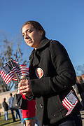 A supporter of Senator and GOP presidential candidate Ted Cruz hands out flags during a campaign event at Ottawa Farms December 19, 2015 in Bloomingdale, Georgia.