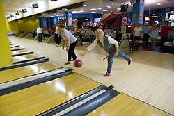 Older woman playing ten pin bowling,