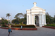 A man and his young daughter play badminton in front of the Park Monument Aayi Mandapam in the Government Park, Pondicherry, India. Pondicherry now Puducherry is a Union Territory of India and was a French territory until 1954 legally on 16 August 1962.