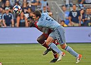 Sporting Kansas City defender Matt Besler (5) battles for the ball during the first half against Chicago Fire forward C.J. Sapong (9) at Children's Mercy Park.