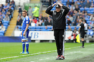Outgoing Cardiff City manager Russell Slade does the 'ayatollah 'for the fans in his last match as manager as it was announced yesterday that he is to be moved upstairs for his new post as Director of Football..  Skybet football league championship match, Cardiff city v Birmingham city at the Cardiff city stadium in Cardiff, South Wales on Saturday 7th May 2016.<br /> pic by Carl Robertson, Andrew Orchard sports photography.