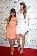 Kourtney Kardashian, left, and Khloe Kardashain attend the launch of 'Kardashian Beauty' at ULTA Beauty in Huntington Beach, California