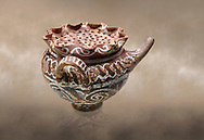 """Minoan Kamares Ware beak spouted """"teapot"""" with herb strainer and  polychrome decorations, Phaistos 1800-1650 BC; Heraklion Archaeological  Museum.<br /> <br /> This style of pottery is named afetr Kamares cave where this style of pottery was first found .<br /> <br /> If you prefer to buy from our ALAMY PHOTO LIBRARY  Collection visit : https://www.alamy.com/portfolio/paul-williams-funkystock/minoan-art-artefacts.html . Type -   Heraklion   - into the LOWER SEARCH WITHIN GALLERY box. Refine search by adding background colour, place, museum etc<br /> <br /> Visit our MINOAN ART PHOTO COLLECTIONS for more photos to download  as wall art prints https://funkystock.photoshelter.com/gallery-collection/Ancient-Minoans-Art-Artefacts-Antiquities-Historic-Places-Pictures-Images-of/C0000ricT2SU_M9w"""