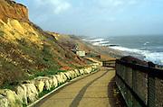 Eroding cliff and hard coastal defences at Barton on Sea, Hampshire, England, UK