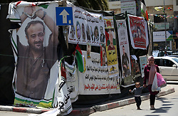 May 7, 2017 - Nablus, West Bank, Palestinian Territory - Palestinians walk past a protest tent in support of Palestinian prisoners on hunger strike in Israeli jails, in the West Bank city of Nablus, on May 7, 2017  (Credit Image: © Ayman Ameen/APA Images via ZUMA Wire)