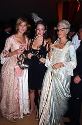 Left to right, LADY CANDIDA BALFOUR, MISS SUSIE STANFORD and LADY ALEXANDRA GORDON-LENNOX at the 2004 Goodwood Revival ball this year theme was a Venetian Masked Ball, held at Goodwood Motor Racing circuit, West Sussex on 4t September 2004.