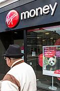 A man walks past a Virgin money high street branch, Enfield, London.