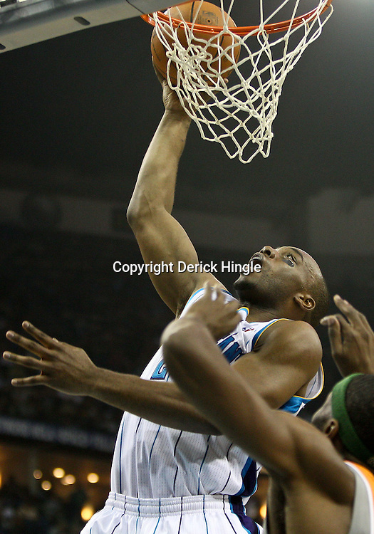 April 8, 2011; New Orleans, LA, USA; New Orleans Hornets power forward Carl Landry (24) shoots over Phoenix Suns power forward Hakim Warrick (21) during the second quarter at the New Orleans Arena.  Mandatory Credit: Derick E. Hingle